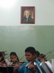 Child practising under Bach El Sistema