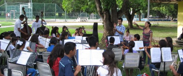 The Orquesta Infantil rehearses under the mango trees